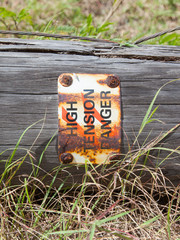 High tension danger sign on a pole
