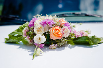 Wedding bouquet of bride lying on table