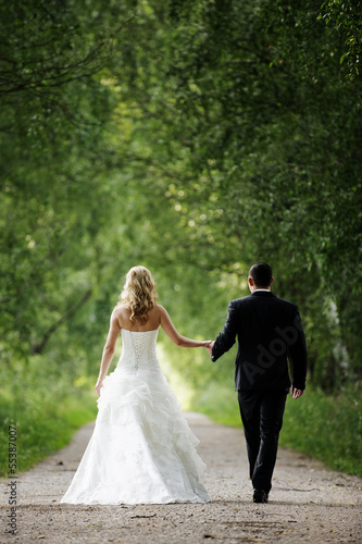 The beautiful happy couple is walking about the marriage ceremon