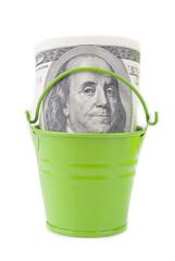Dollars in green bucket.