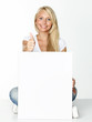 Woman with white message board shows thumb up