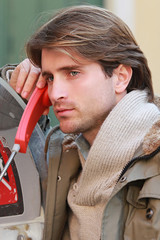 handsome guy talking on phone