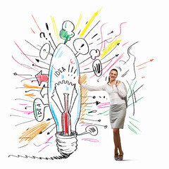 Businesswoman leaning on bulb