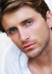 portrait of handsoome guy with blue eyes
