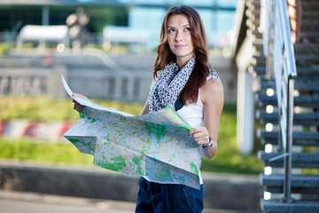 young woman tourist with map outdoors