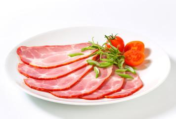Slices of smoked pork neck