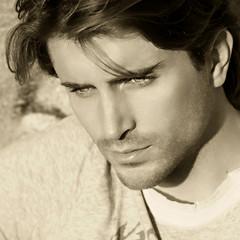 portrait of beautiful man model sepia toned