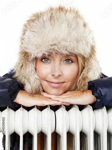 Romantic winter lady with cap and radiator