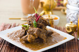 mutton korma famous food with traditional indian background item