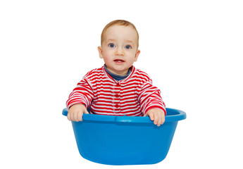 Adorable baby sit in a blue basin