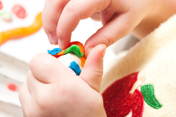 Child's hands with plasticine