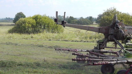Agricultural machinery at work on farm land