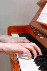 Pianist hands profile view
