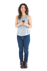 Cheerful attractive brunette texting