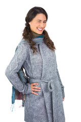 Smiling model with winter clothes winking at camera