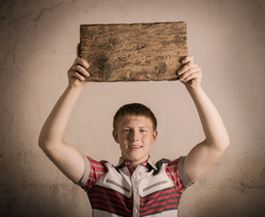young man holding wooden table