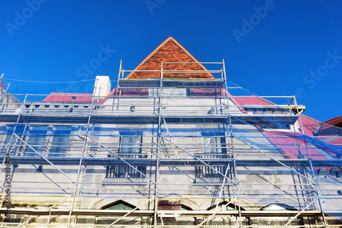 house facade restoration with scaffolding