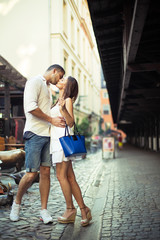 Couple in love kissing each other in city center