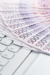 Online banking, European paper currency on the computer keyboard