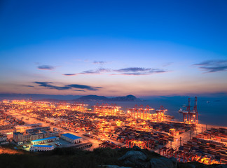 container terminal with sunset glow