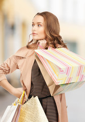 woman with shopping bags in ctiy