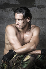 portrait of handsome muscle athlete looking aside