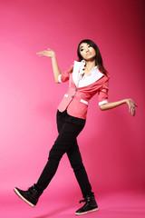 Asian Amusing Teenager Walking in Pink Studio