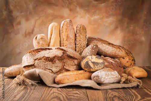 Fotobehang Bakkerij Fresh bread on wood