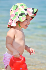 happy baby on the beach