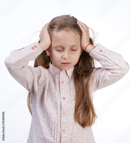 Little girl suffering from headache