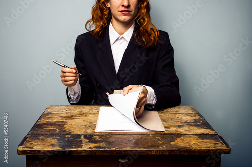 Businesswoman about to sign contract