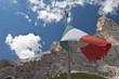 Italian flag in front of the Dolomites