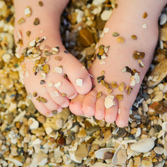 small children's feet in the sand