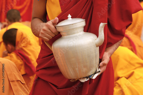 Tibetan tea teapot in the hands of a monk in Nepal