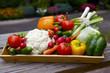 Vegetables in wooden container on outside in the garden