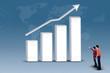 Business partnership looking at increasing bar chart