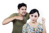 Boyfriend in rage behind girlfriend - isolated poster