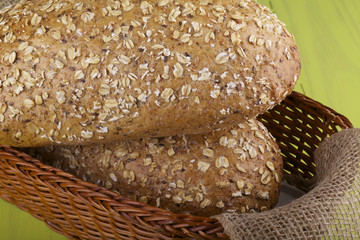 Two whole loaves of five grain breads in a basket