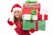 Beautiful woman holding christmas presents and credit card