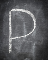 P - letter written on black chalkboard.