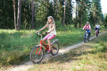 Children riding bikes in woods
