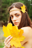 Autumn woman on leafs background