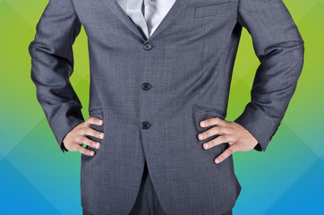 Businessman in suit, hands on hips