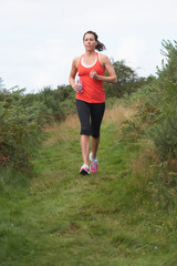 Woman On Run In Countryside