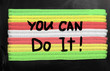 """You can do it"" handwritten with white chalk on a blackboard"