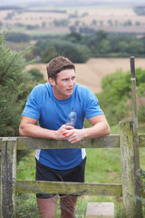 Man Resting During Run In Countryside