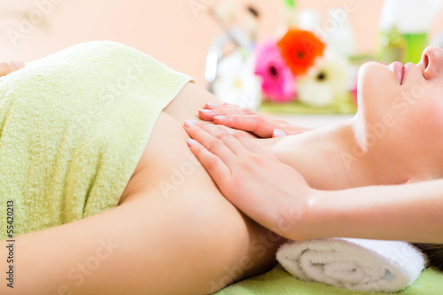 Wellness - woman getting shoulder massage in Spa