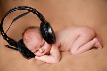 baby and earphones