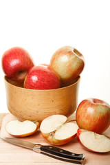 Cut Apples by Whole Apples in a Wood Bowl