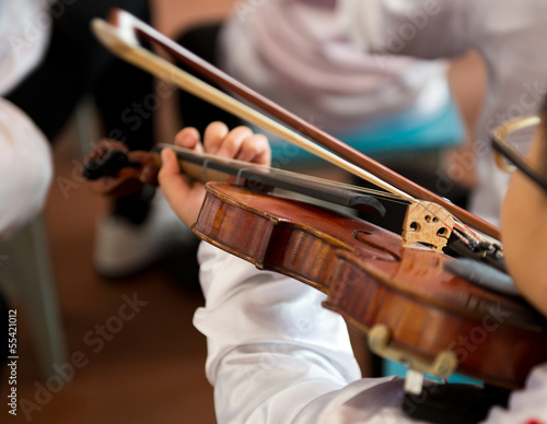playing the violin.